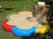 Детская песочница из колеса
