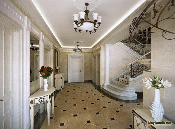 Возвышенный интерьер прихожей в доме с лестницей