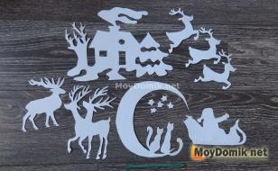 Вырезанные из бумаги фигурки для украшения окна к Новому году