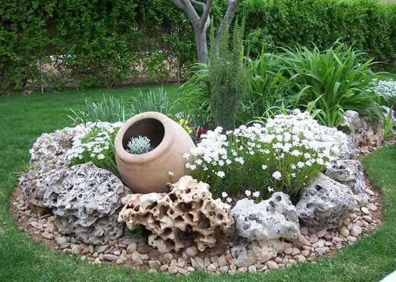 Клумбы из камня для цветов своими руками фото