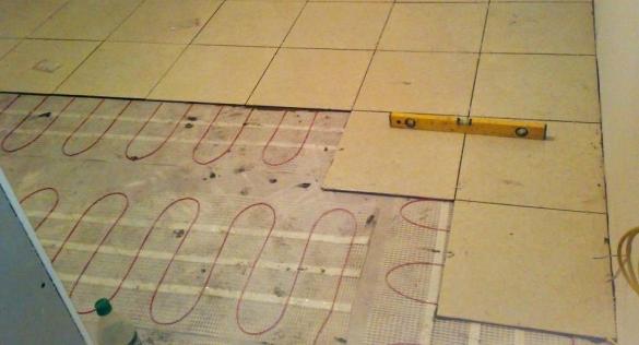 Укладка электрического теплого пола под плитку без стяжки